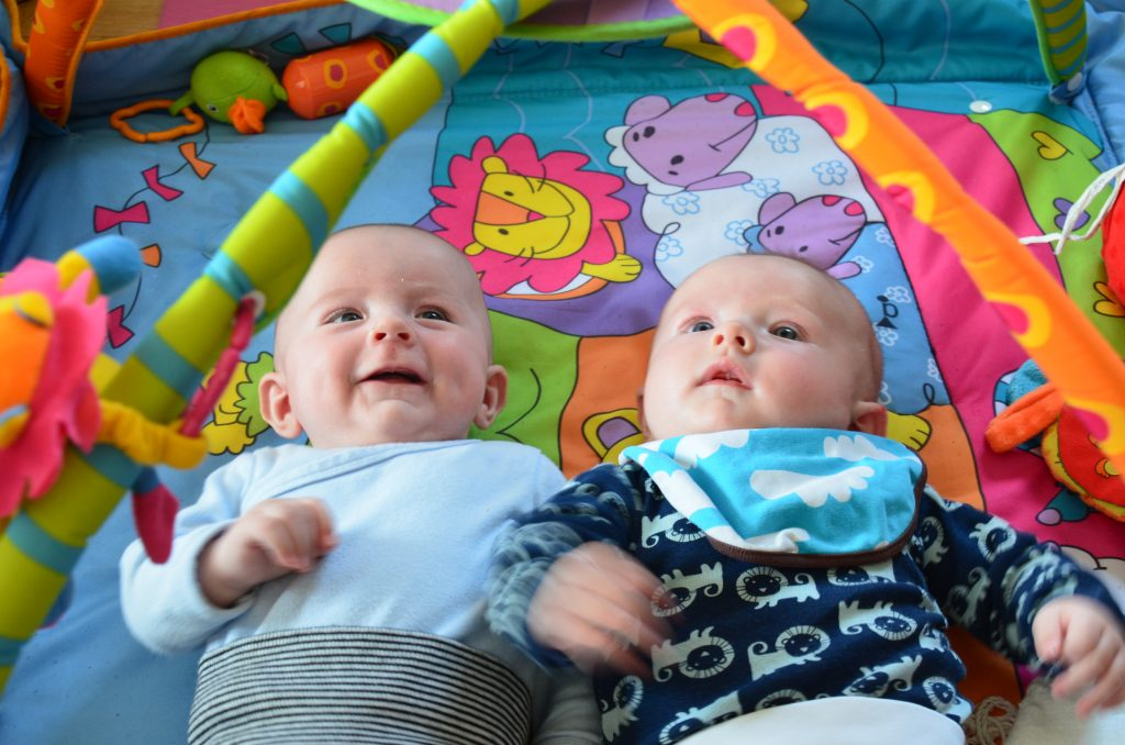 Infants in baby gym